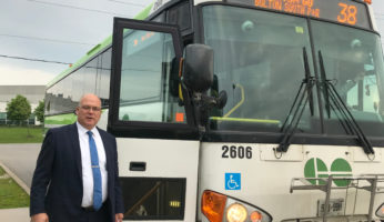 Mayor Beside Bus