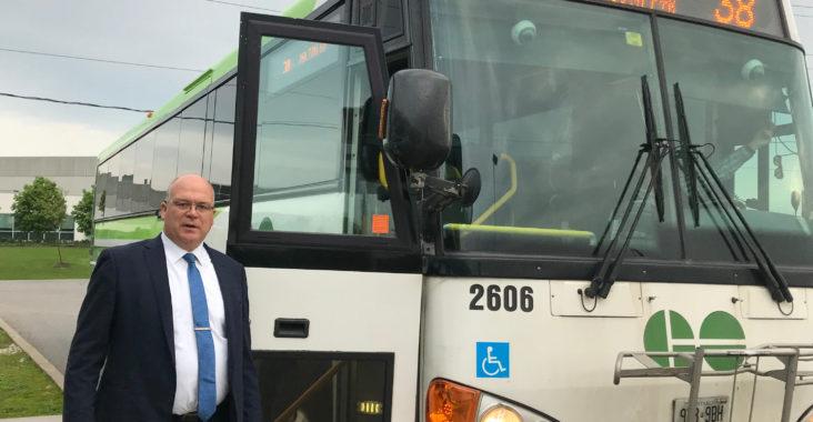 Mayor Beside Bus